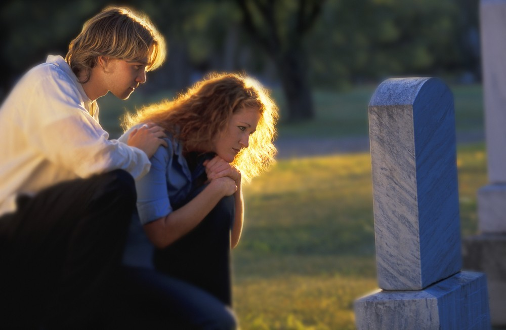 Brother and sister visiting grave site